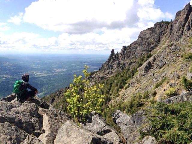 A hiker takes a break on Mount Si. Photo by Kayla Burton.