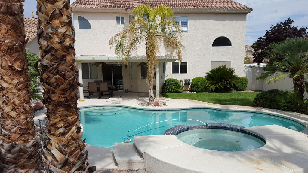 Private Backyard with Covered Patio and Pool/Jacuzzi